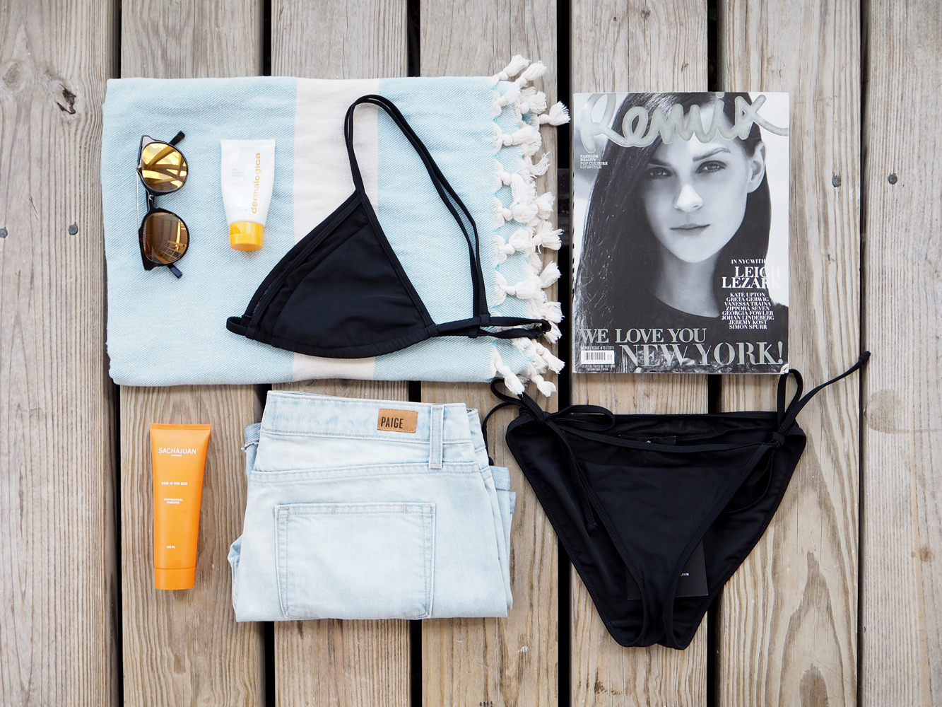 StyleAndMinimalism | Travel | Antigua | Hammam towel, Kite sunglasses, Designers Remix black bikini, Dermalogica face suncream, Remix magazine, Paige denim shorts and Sachajuan Hair In The Sun protector