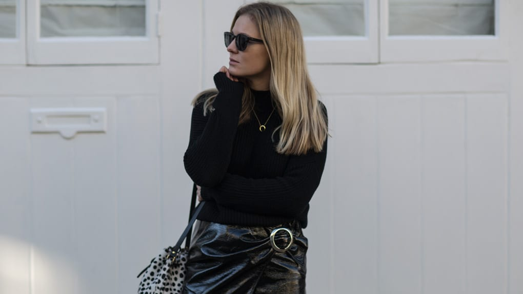 AV Black Sweater, Mango Patent Skirt, Seven Boot Lane Black Ankle Boots, Baia Leopard Print Bucket Bag