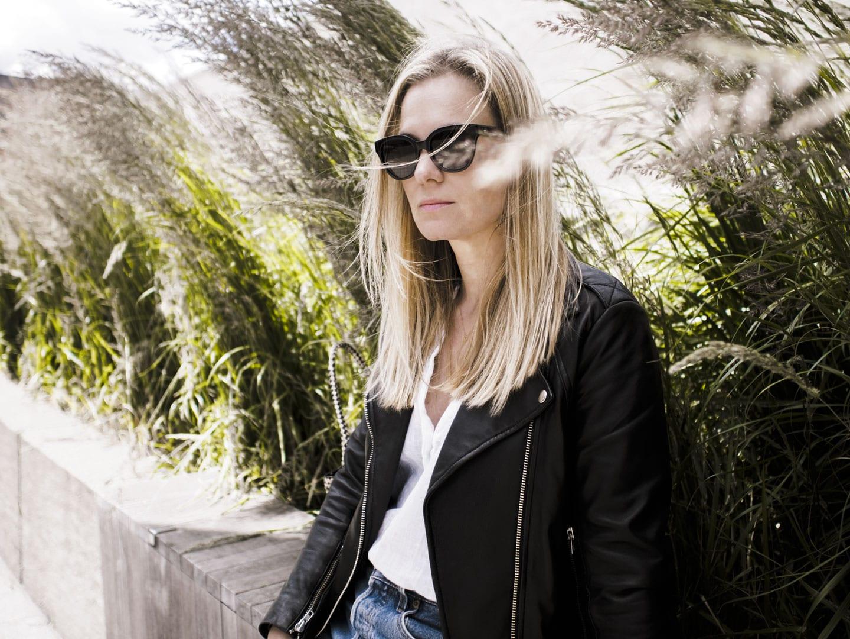 Vikki wears The White Company Linen Blouse, Ace & Tate black sunglasses and Sandro biker jacket