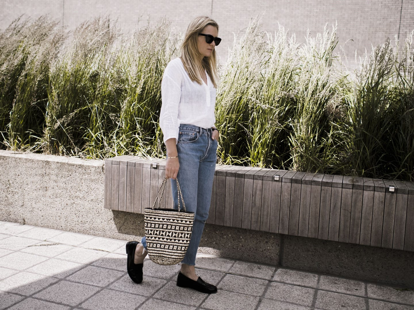 Vikki wears The White Company Linen Blouse, Levi 501s, Bass Weejun loafers and Straw Bag