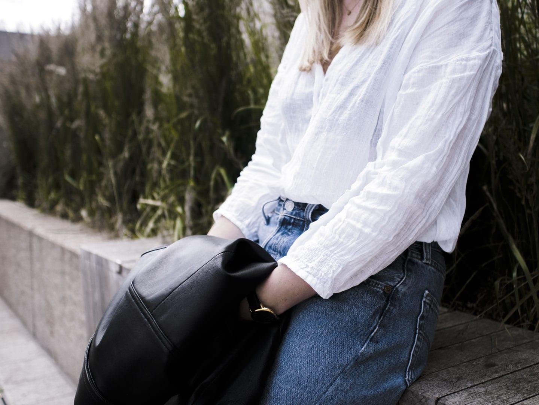 Vikki wears The White Company Linen Blouse, Levi 501s and Sandro biker jacket
