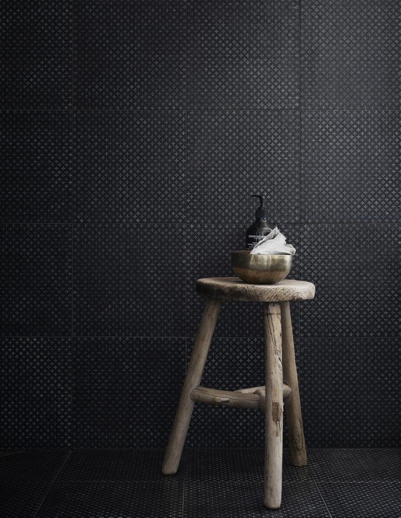 Wooden stool in black tiled shower | Home of Artilleriet's Owners