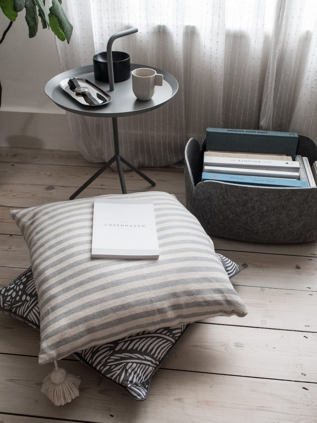 Hay DLM Side Table Grey, Normann Copenhagen Moon Tray Black, Hay Tray, Hay Paper Porcelain Coffee Cup, Wood/Grey Cushion, Happy & Co Cushion, Muuto Restore Storage Basket & Books | Minimalist Interiors Good For You