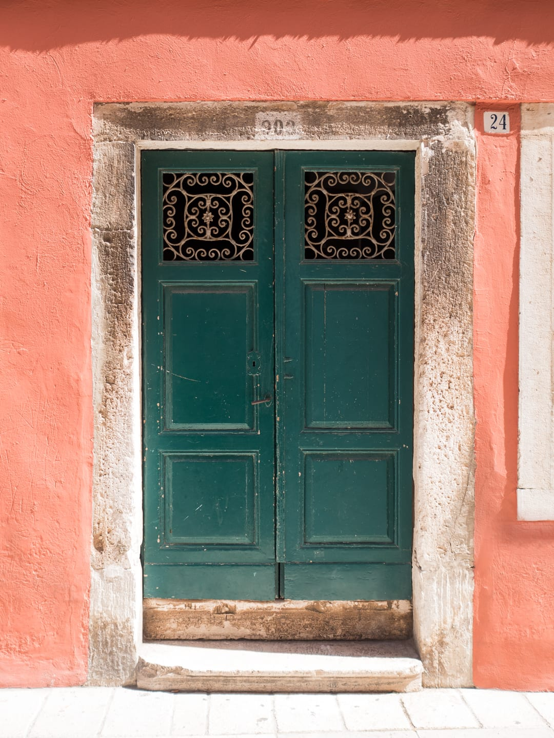 Green doorway & peach wall - Rovinj, Croatia