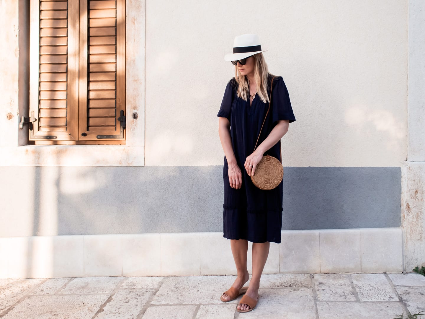 Out-Of-Office | Raquel Allegra Peasant Dress, Davina Mulford Panama, Ancient Greek Sandals, Wood/Grey Woven Bag
