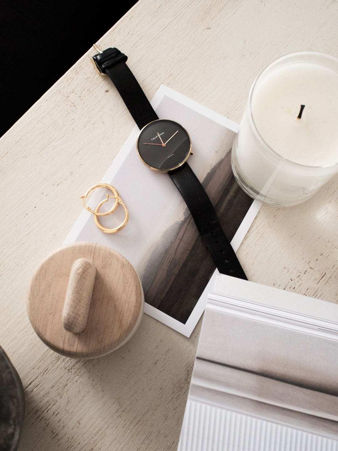 Skagerak pot, Cate & Nelson watch, Otiumberg gold hoops, The White Company Sandlewood candle, Cereal magazine